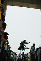 Ghana, Accra, 2007. Inline skaters delight the crowds by putting on a show beneath the triumphal arch on Independence Square.