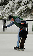 25 DEC. 2010 -- ST. LOUIS --  SIx-year-old Liam Rich and his dad Steve Rich skate across the ice during a Christmas Day skating session at the Steinberg Skating Rink in Forest Park in St. Louis Saturday, Dec. 25, 2010. The Rich family, which includes mom Heather Rich and sister Norah Rich, 2, is from Fenton, Mo. Image © copyright 2010 by Sid Hastings.