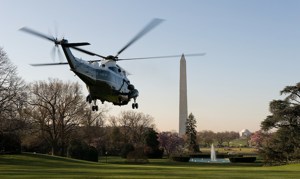 US President Barack Obama and First Lady Michelle Obama, aboard the  Marine One helicopter, depart the White House in Washington, DC, USA on 31 March 2009. The Obamas are traveling to the United Kingdom, where the president to attend the G20 Summit.