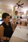 Sandy Beach Resort on China Beach. Nicole Schmidt tasting wine.