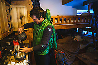 Waking up slow as Eric Johnson makes breakfast at the Mount Hayden Backcountry Lodge, San Juan Mountains.