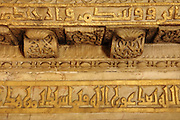 Detail from inside the mihrab, with carved marble and kufic inscriptions in gold, in the Cathedral-Great Mosque of Cordoba, in Cordoba, Andalusia, Southern Spain. The first church built here by the Visigoths in the 7th century was split in half by the Moors, becoming half church, half mosque. In 784, the Great Mosque of Cordoba was begun in its place and developed over 200 years, but in 1236 it was converted into a catholic church, with a Renaissance cathedral nave built in the 16th century. The historic centre of Cordoba is listed as a UNESCO World Heritage Site. Picture by Manuel Cohen