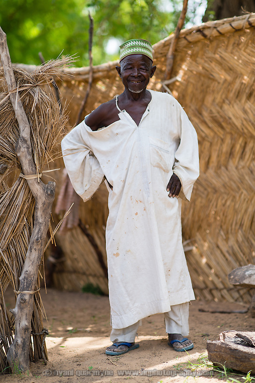 Mallam Sofiana outside the reed wall around a latrine at his hom in the village of Tammé-Tammé in the Zinder Region of Niger on 25 July 2013. It was built as part of a WaterAid Community-Led Total Sanitation (CLTS) program.
