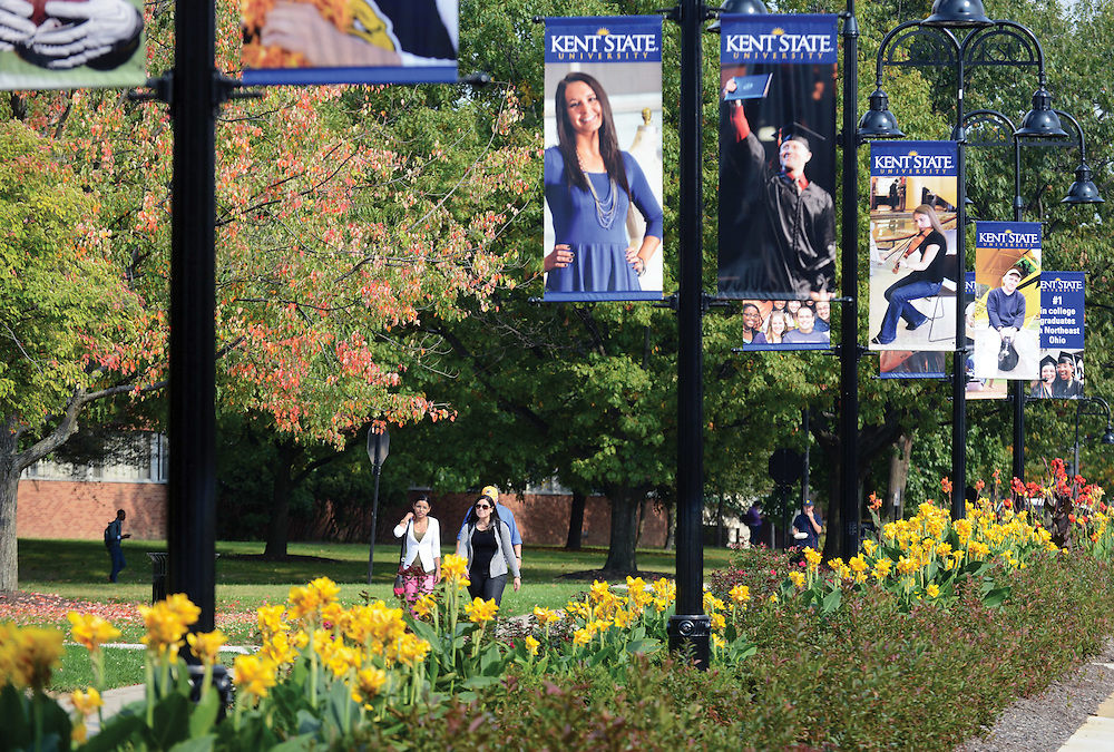 Students walk toward the student center through the Murin Gardens near the Kent State Library.