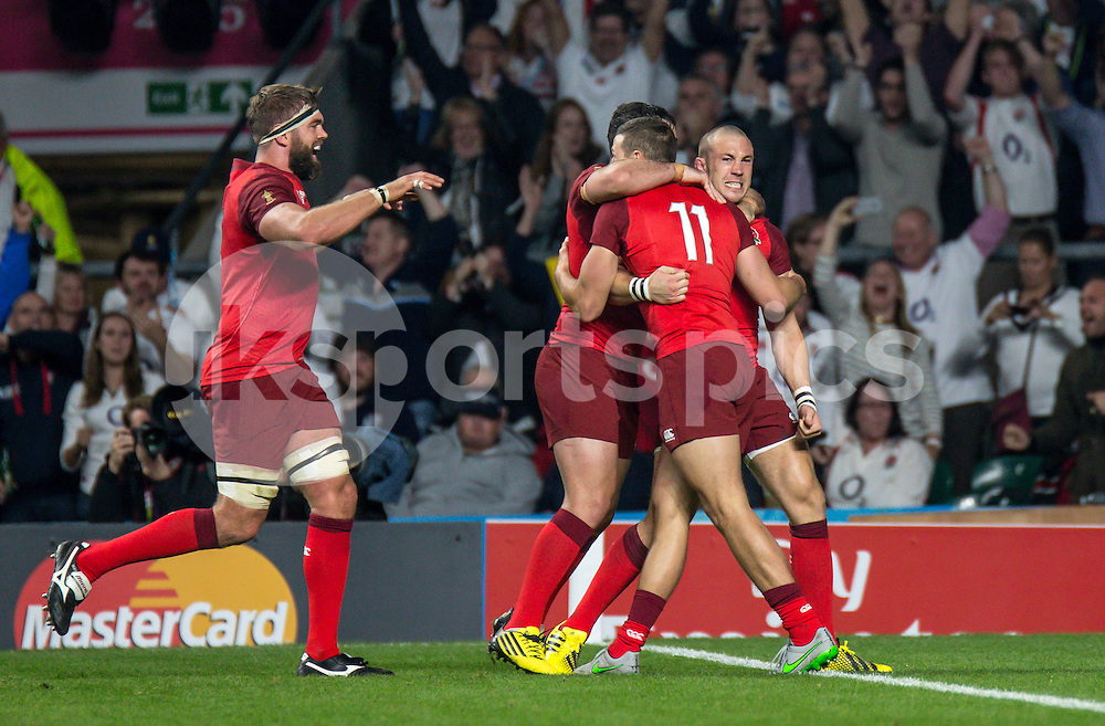 Mike Brown of England celebrates his try during the Rugby World Cup 2015 Pool A match between England and Fiji played at Twickenham Stadium, London on 18 September 2015. Photo by Liam McAvoy.