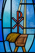 Stained glass depicting the manger and star for the birth of Jesus Christ (Luke 2) and the Chi Rho symbol on Wednesday, May 13, 2020, at St. Paul's Lutheran Church, Columbia, Ill. LCMS Communications/Erik M. Lunsford