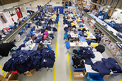 © Licensed to London News Pictures. 17/04/2020. London, UK. Machinists sew medical clothing for the NHS (National Health Service) at Fashion-Enter Ltd's factory. The British government continues to try to combat the COVID-19 outbreak, with many garment manufacturers across the country turning to produce medical equipments for the NHS. Photo credit: Ray Tang/LNP