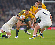 Israel Folau is tackled during the Rugby World Cup Pool A match between England and Australia at Twickenham, Richmond, United Kingdom on 3 October 2015. Photo by Ian Muir.during the Rugby World Cup Pool A match between England and Australia at Twickenham, Richmond, United Kingdom on 3 October 2015. Photo by Ian Muir.