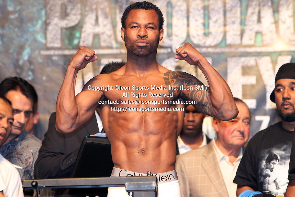 May 6, 2011 - Las Vegas, Nevada, U.S. - SHANE MOSLEY weighs in. Six thousand fans, including the first arrival at 5 a.m., jammed MGM Grand Garden Arena Friday for the Free Public Weigh-in featuring Manny Pacquiao and Shane Mosley. Another 2,000 were turned away. Tomorrow/Saturday, May 7, at the sold-out MGM Grand Garden Arena, eight-division world champion Pacquiao (52-3-2, 38 KOs), of General Santos City, Philippines, will risk his WBO welterweight title against three-division world champion Shane Mosley (46-6-1, 39 KOs), of Pomona, Calif., in the highly anticipated main event of a four-fight telecast produced and distributed live by SHOWTIME PPV beginning at 9 p.m. ET/6 p.m. PT