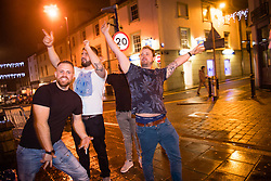 © Licensed to London News Pictures. 22/12/2017. Aberystwyth, Wales, UK. People out on the town in Aberystwyth on Mad Friday or Booze Black Friday, the last Friday night before Christmas Day, when traditionally workers in the go out to celebrate the start of their Christmas holidays with colleagues , safe in the knowledge that they have the entire weekend in which to recover. Photo credit: Keith Morris/LNP