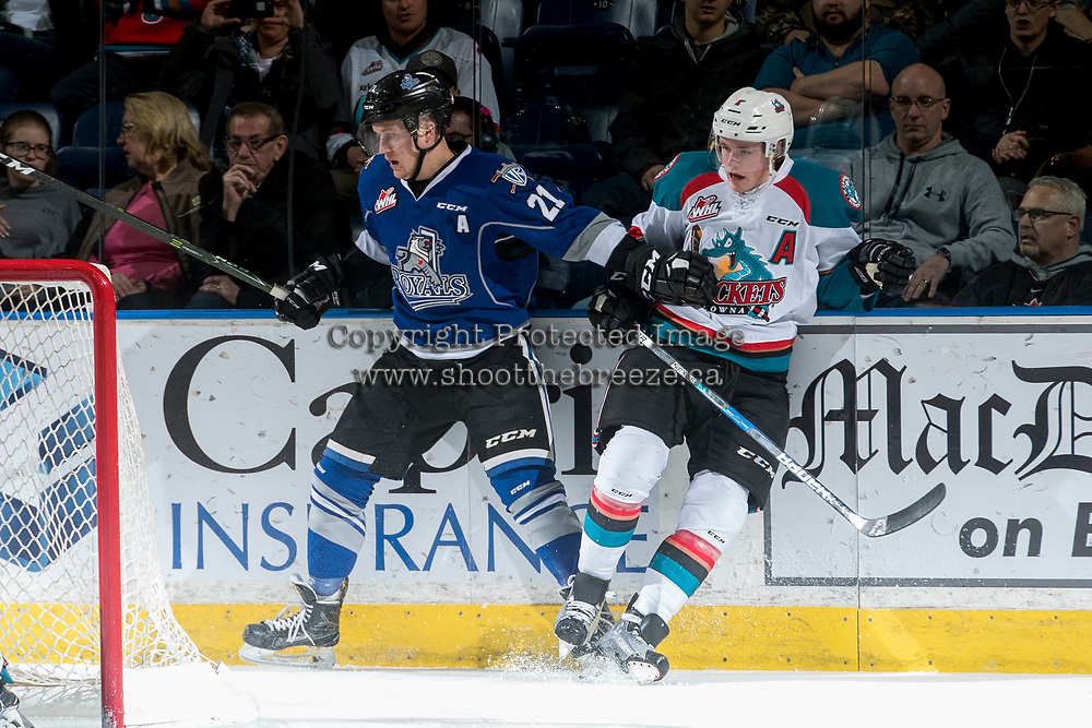 KELOWNA, CANADA - MARCH 11: Carter Folk #21 of the Victoria Royals checks Lucas Johansen #7 of the Kelowna Rockets into the boards during first period on March 11, 2017 at Prospera Place in Kelowna, British Columbia, Canada.  (Photo by Marissa Baecker/Shoot the Breeze)  *** Local Caption ***