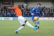 AFC Wimbledon defender Callum Kennedy (23) battles for possession with Southend United forward Marc-Antoine Fortune (9) during the EFL Sky Bet League 1 match between AFC Wimbledon and Southend United at the Cherry Red Records Stadium, Kingston, England on 1 January 2018. Photo by Matthew Redman.