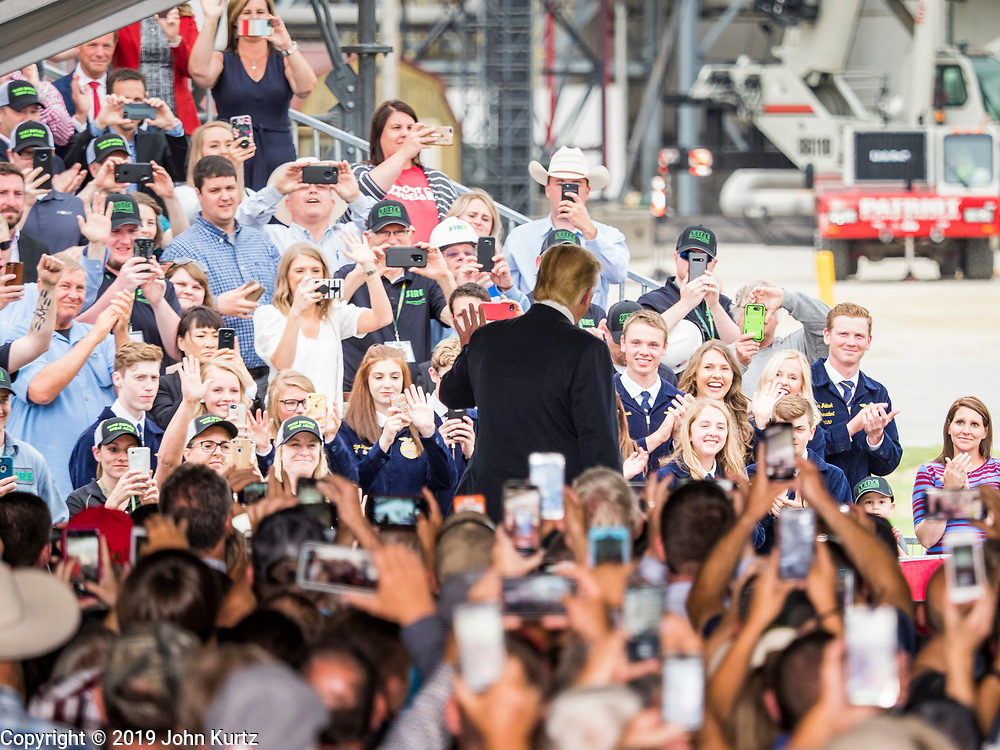 11 JUNE 2019 - COUNCIL BLUFFS, IOWA: President Donald Trump waves to Iowa and Nebraska farmers who came to see him at Southwest Iowa Renewable Energy. President Trump visited Southwest Iowa Renewable Energy in Council Bluffs Tuesday to announce that his administration was relaxing rules on E15, an ethanol additive for gasoline. Iowa is one of the leading ethanol producers in the U.S. and Iowa corn farmers hope the administration's change in E15 rules will spur demand for corn.          PHOTO BY JACK KURTZ