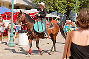 "01 SEPTEMBER 2011 - ST. PAUL, MN: A woman rides a horse through the crowd at the Minnesota State Fair. The Minnesota State Fair is one of the largest state fairs in the United States. It's called ""the Great Minnesota Get Together"" and includes numerous agricultural exhibits, a vast midway with rides and games, horse shows and rodeos. Nearly two million people a year visit the fair, which is located in St. Paul.   PHOTO BY JACK KURTZ"