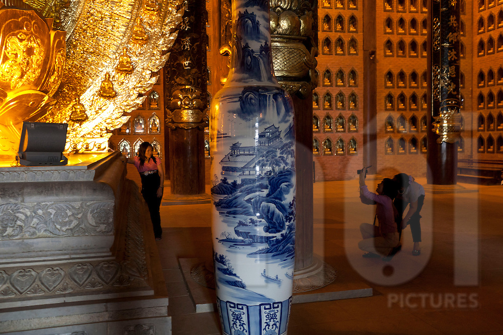 Visitors taking photographs in Bai Dinh pagoda, considered as the largest complex of Buddhist temples in Vietnam, Asia