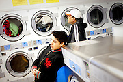 Eduardo Barajas and his father Roberto wait for clothes to dry at Coin Laundry in East Point, Georgia December 30, 2009. Monica, Eduardo's mother, has been separated from her husband and son so she could continue dialysis in Mexico.