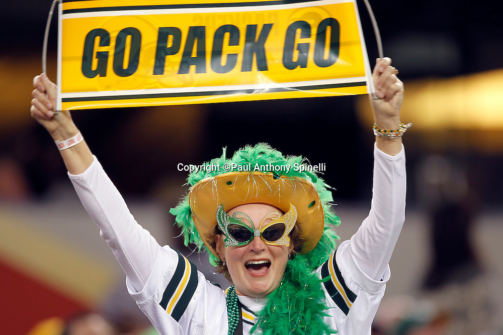 "A Green Bay Packers fan waves a ""Go Pack Go"" sign while wearing a team jersey and a cheese head hat during Super Bowl XLV against the Pittsburgh Steelers on Sunday, February 6, 2011, in Arlington, Texas. The Packers won the game 31-25. ©Paul Anthony Spinelli"