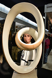 """© Licensed to London News Pictures. 03/10/2017. London, UK. A visitor views """"White Ravel in H, VII"""", 2016, a sculpture by Richard Fox at the Decorative Antiques & Textiles Fair taking place at Evolution in Battersea Park which runs 3-8 October 2017 and features more than 160 exhibitors. Photo credit : Stephen Chung/LNP"""