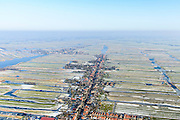 Nederland, Noord-Holland, gemeente Wormerland, 28-10-2016; Wormer met Dorpsstraat, richting Jisp. Achtergrond Polder Wormer, Jisp en Nek.<br /> Polders east of Amsterdam with villages.<br /> <br /> luchtfoto (toeslag op standard tarieven);<br /> aerial photo (additional fee required);<br /> copyright foto/photo Siebe Swart