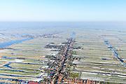 Nederland, Noord-Holland, gemeente Wormerland, 28-10-2016; Wormer met Dorpsstraat, richting Jisp. Achtergrond Polder Wormer, Jisp en Nek.<br /> Polders east of Amsterdam with villages.<br /> <br /> luchtfoto (toeslag op standard tarieven);<br /> aerial photo (additional fee required);<br /> copyright foto/photo Siebe Swart
