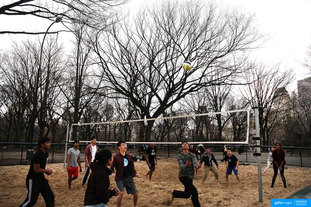 A recreational beach volleyball game in Central Park, Manhattan, New York, USA. 26th March 2013. Photo Tim Clayton