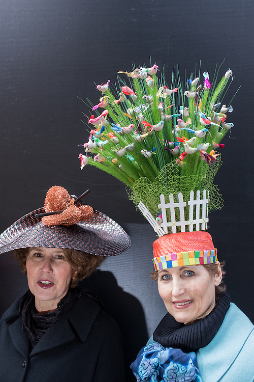New York, NY, USA-27 March 2016. Two women wearing hats decorated with several spring themes in the annual Easter Bonnet Parade and Festival.