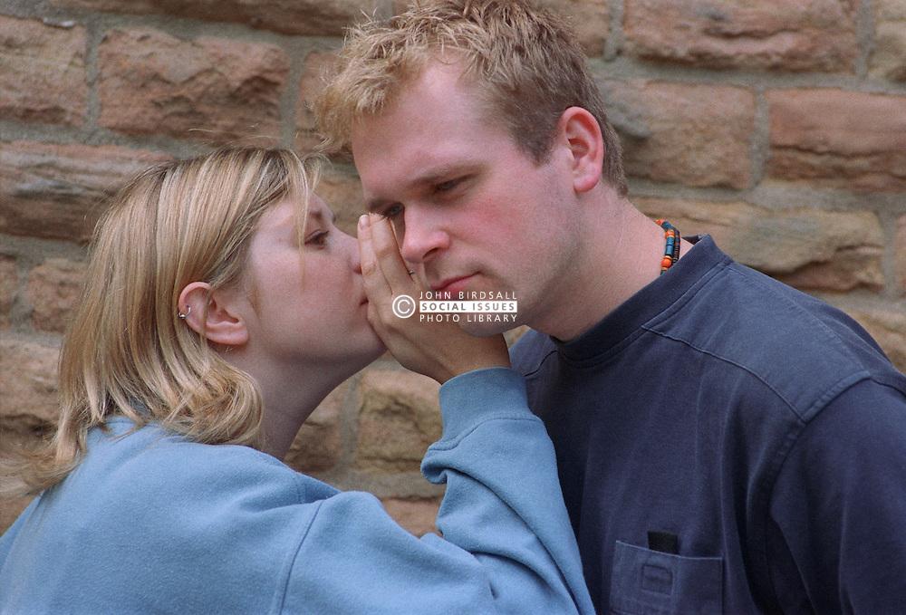 Teenage girl whispering in friend's ear,