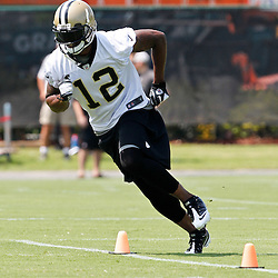 June 6, 2012; Metairie, LA, USA; New Orleans Saints wide receiver Marques Colston (12) during a minicamp session at the team's practice facility. Mandatory Credit: Derick E. Hingle-US PRESSWIRE