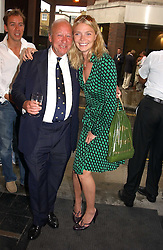 JODIE KIDD and ALEXANDER FYSHE head of the Maserati owners Club at an exhibition of photographs featuring Maserati cars held at the Michael Hoppen Gallery, 3 Jubilee Place, London SW3 on 13th July 2005.<br /><br />NON EXCLUSIVE - WORLD RIGHTS