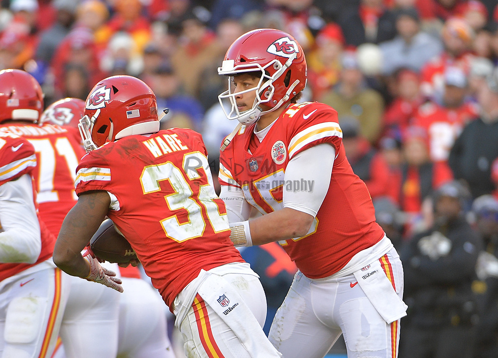 Dec 9, 2018; Kansas City, MO, USA; Kansas City Chiefs quarterback Patrick Mahomes (15) hands off to running back Spencer Ware (32) during the second half against the Baltimore Ravens at Arrowhead Stadium. Mandatory Credit: Denny Medley-USA TODAY Sports
