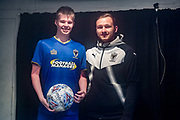 AFC Wimbledon Midfielder Dean Parrett (18) is awarded the man of the match by the match day mascot after the EFL Sky Bet League 1 match between AFC Wimbledon and Fleetwood Town at the Cherry Red Records Stadium, Kingston, England on 30 March 2018. Picture by Stephen Wright.
