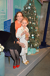 LEAH WOOD and her daughter MAGGIE DYLAN at the official opening of the 2014 Tiffany & Co.Christmas Shop on Bond Street, London on 16th November 2014.