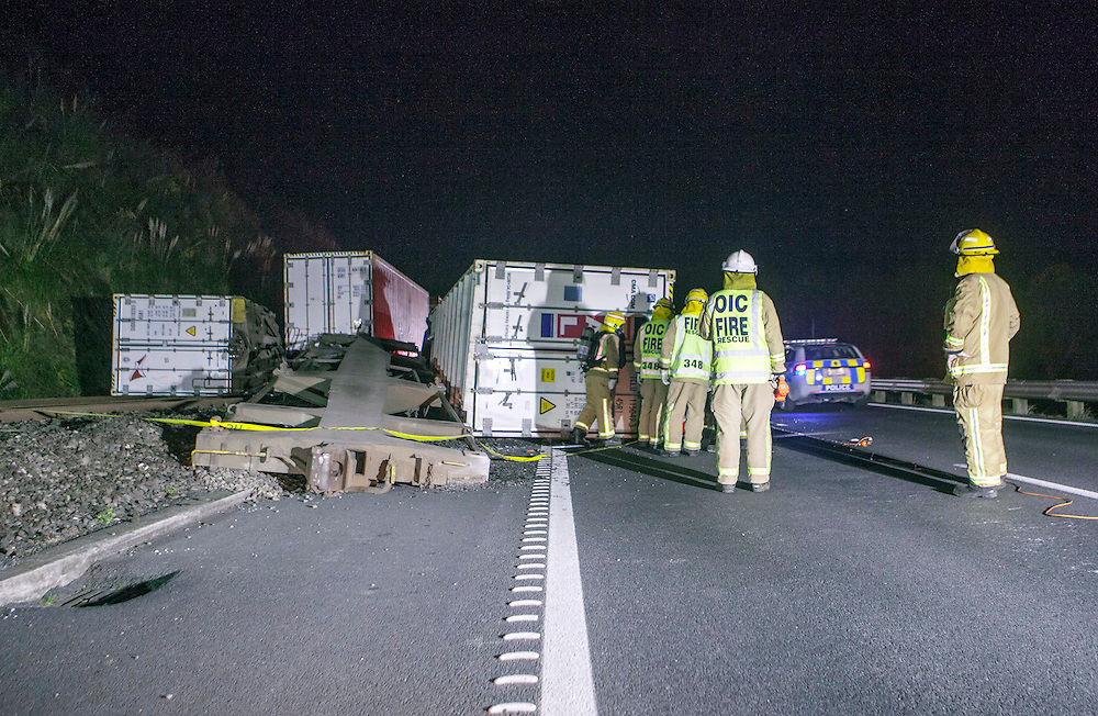 Fire crews were called to a derailed Kiwirail freight train blocking SH1 after containers believed to be carrying hazardous goods spread across the motorway north of Mercer, New Zealand, Tuesday, Speptember 03, 2013. Credit:SNPA / Bradley Ambrose