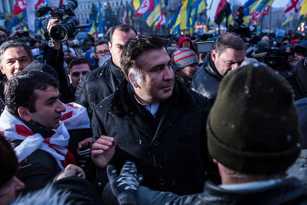 KIEV, UKRAINE - DECEMBER 7: Mikheil Saakashvili, the former president of Georgia, arrives on Independence Square in support of anti-government protesters on December 7, 2013 in Kiev, Ukraine. Thousands of people have been protesting against the government since a decision by Ukrainian president Viktor Yanukovych to suspend a trade and partnership agreement with the European Union in favor of incentives from Russia. (Photo by Brendan Hoffman/Getty Images) *** Local Caption *** Mikheil Saakashvili