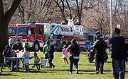 The Easter Bunny arrives to Winnequah Park via Monona Fire Engine at the 21st Annual Easter Egg Hunt in Monona, WI on Saturday, April 20, 2019.