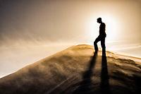 Silhouette of a man on a dune at Ribanceira Beach. Imbituba, Santa Catarina, Brazil. / <br /> Silhueta de um homem sobre duna na Praia da Ribanceira. Imbituba, Santa Catarina, Brasil.