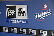 LOS ANGELES, CA - APRIL 28:  The Los Angeles Dodgers logo is painted on the dugout wall for the game against the Milwaukee Brewers on Sunday, April 28, 2013 at Dodger Stadium in Los Angeles, California. The Dodgers won the game 2-0. (Photo by Paul Spinelli/MLB Photos via Getty Images)