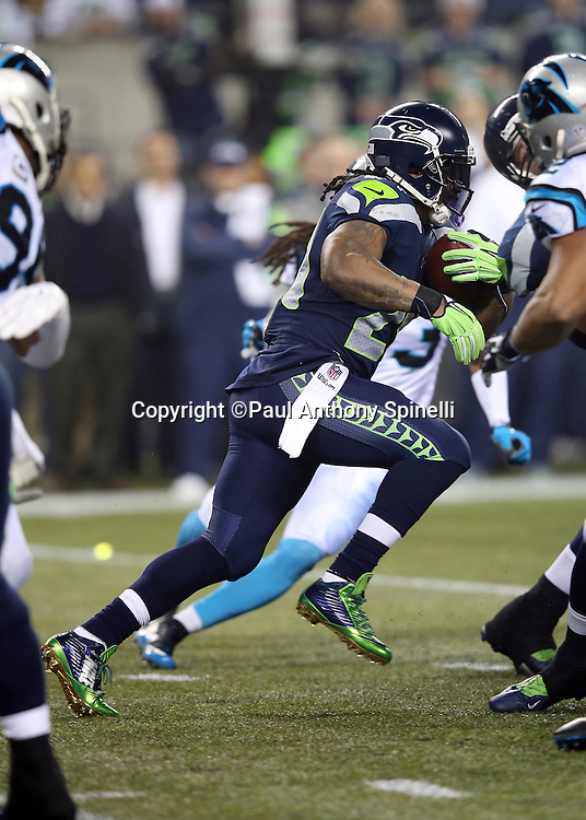 Seattle Seahawks running back Marshawn Lynch (24) runs for a gain of second quarter gain of 8 yards during the NFL week 19 NFC Divisional Playoff football game against the Carolina Panthers on Saturday, Jan. 10, 2015 in Seattle. The Seahawks won the game 31-17. ©Paul Anthony Spinelli