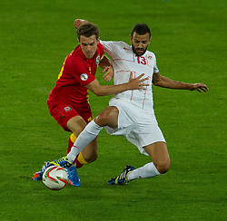 10.09.2013, Stamford Bridge, Cardiff, ENG, FIFA WM Qualifikation, Wales vs Serbien, Rueckspiel, im Bild Wales' Aaron Ramsey, left, fights for the ball with Serbia's Ivan Radovanovic during the FIFA World Cup Qualifier second leg Match between Wales and Serbia at the Stamford Bridge stadium in Cardiff, Great Britain on 2013/09/10. EXPA Pictures © 2013, PhotoCredit: EXPA/ Propagandaphoto/ Tom Hevezi<br /> <br /> ***** ATTENTION - OUT OF ENG, GBR, UK *****