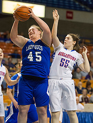 Buckhannon Upshur center Megan Wilfong (45) rebounds over Morgantown center Shelby` Boyle (55) during a first round game at the Charleston Civic Center.