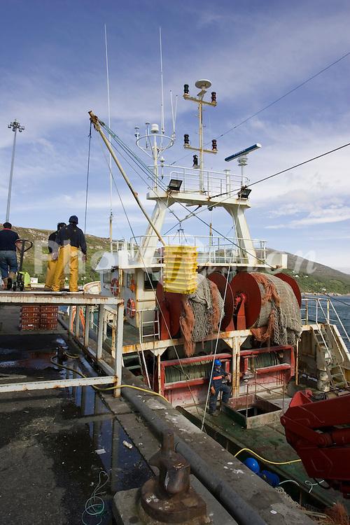 Trawler unloading fish onto Italian truck; Ullapool; NW Scotland