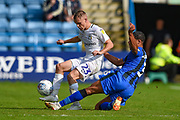 Coventry City midfielder Luke Thomas (23) and Gillingham FC defender Bradley Garmston (3) during the EFL Sky Bet League 1 match between Gillingham and Coventry City at the MEMS Priestfield Stadium, Gillingham, England on 25 August 2018.