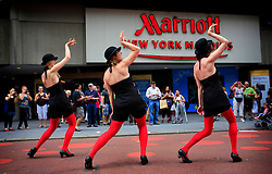 USA NEW YORK 5JUN10 - A group of female performers stage a show in Times Square in midtown Manhattan, New York.<br />