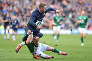 Finn Russell is tackled by Keith Earls during the 6 Nations match between Scotland and Ireland at Murrayfield, Edinburgh, Scotland on 9 February 2019.