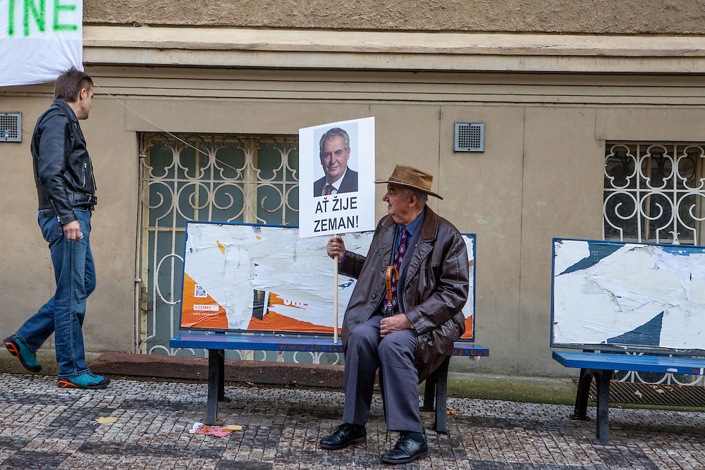 """A supporter of Czech President Milos Zeman holding a sign where is written """"Long live Zeman"""" during an anti-Islam rally in Prague. Czech Republic celebrates that day the 26th anniversary of the Velvet Revolution which took place in 1989."""