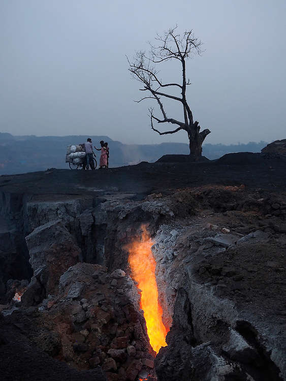 Children and women doing heavy labor in the coal fields near Jharia, India.
