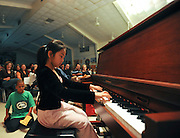 "10/23/09  -  Atlanta, Ga :  Students at Sagamore Hills Elementary School including Tia Li playing piano for ""Sonatina Opus 36 No. 5 Clementi"" perform their skits during the 2009 talent show featuring dance, music, comedy and other performances at the annual Showcase of Stars on Friday, October 23, 2009. Director Nancy Briggs, and assistant directors Joe Scivicque and Teresa Libbey helped produce more than 30 acts.    David Tulis         dtulis@gmail.com    ©David Tulis 2009"