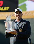 Brooks Koepka with the trophy after winning Japan Tour's Dunlop Phoenix Tournament 2017<br /> <br /> Golf Pictures Credit by: Mark Newcombe / visionsingolf.com