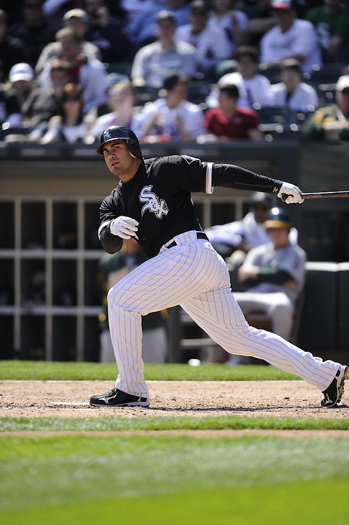 CHICAGO - APRIL 13:  Carlos Quentin #20 of the Chicago White Sox bats against the Oakland Athletics on April 13, 2011 at U.S. Cellular Field in Chicago, Illinois.  The Athletics defeated the White Sox 7-4 in ten innings.  (Photo by Ron Vesely)  Subject: Carlos Quentin