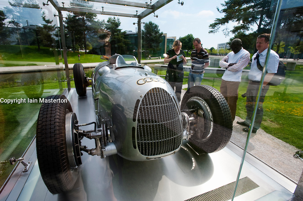 Antique Audi racing car in glass display case at Volkswagen Autostadt or Car City in Wolfsburg Germany